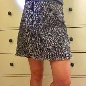Textured skirt with with fringe hem.